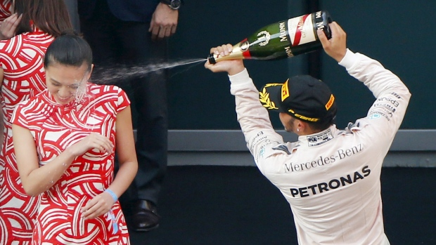 Lewis Hamilton Sprays Champagne After Winning the F1