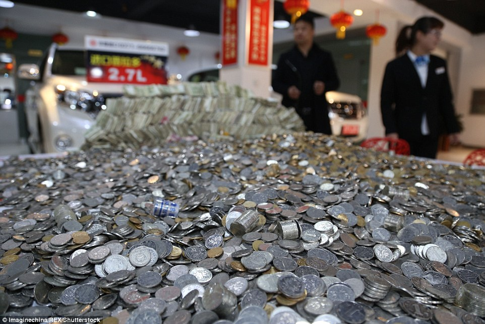 Chinese Man Pays for New Car with 100,000 Spare Coins