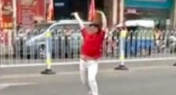 Woman Strips in Street After Getting Scammed by Cab Driver in Guangdong