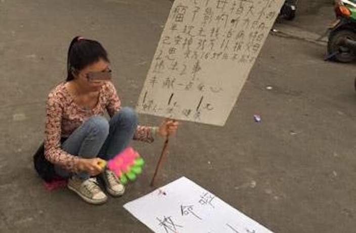Beggar Puts Herself on Sale for ¥350,000