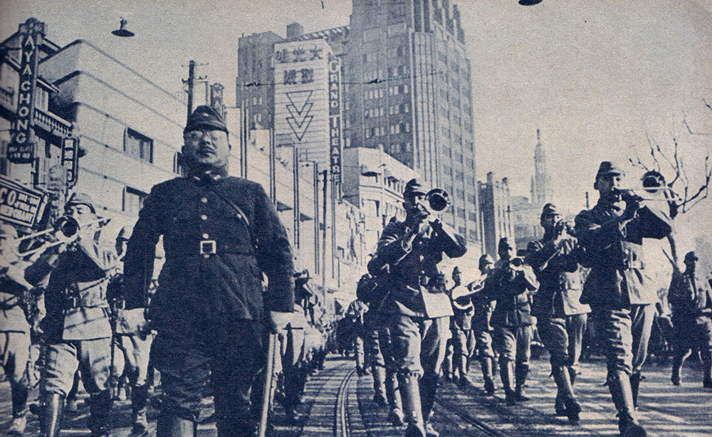 A Japanese Army band marches up Nanjing Xi Lu past the Park Hotel and the Grand Theatre during a large parade to celebrate their capture of the International Settlement in December 1941