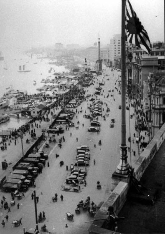 A Japanese sailor looks down on the occupied Bund shortly after the takeover