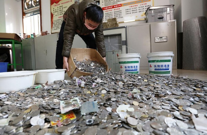 Sichuan Town Stuck with 2 Tons of Phoney Coins Used as Bus Fare