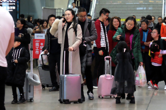 PHOTOS: Traffic Jams, Packed Train Stations as CNY Travelers Go Back to Work