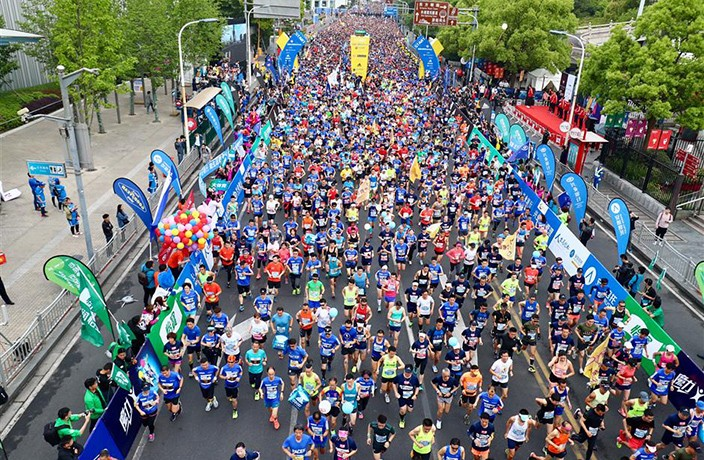 PHOTOS: 15,000 Runners Take to the Streets in Shanghai Half Marathon