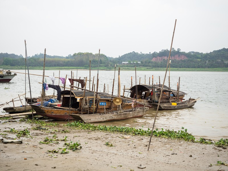 Laundry-dries-near-fishing-boats-on-the-Bei-River.jpg
