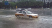 Heavy Rainfall Continues to Wreak Havoc on Beijing Streets