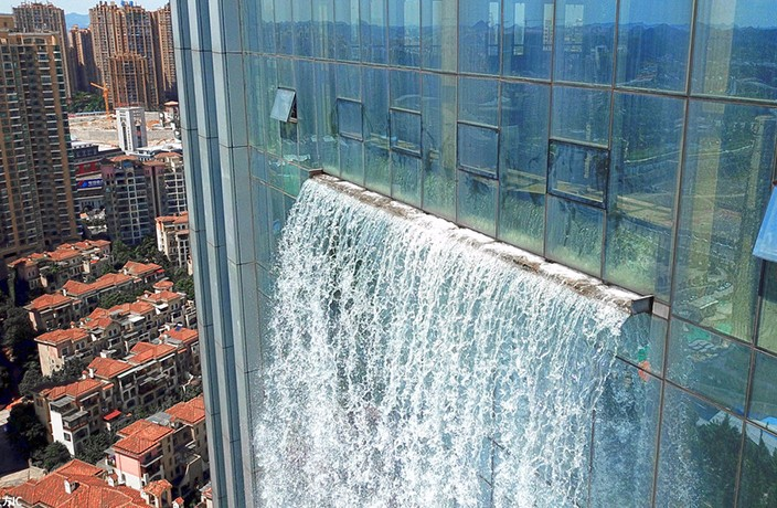 Artificial Skyscraper Waterfall Stirs Controversy in South China