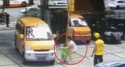 WATCH: Woman Pushes Son in Front of Moving Vehicle in Guangzhou