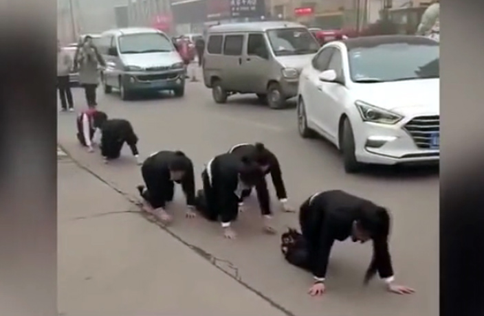 WATCH: Chinese Workers Crawl on Street After Failing to Meet Targets