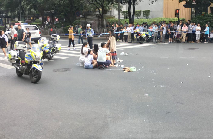 Car Plows Through Packed Crosswalk in Guangzhou