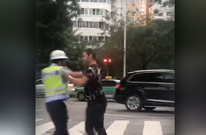 WATCH: Foreign Student Attacks Traffic Police in South China
