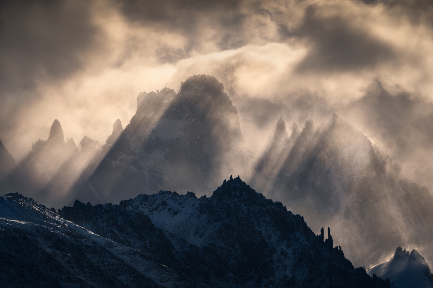 Warm-lights-shine-through-the-thick-cloud-on-parts-of-the-famous-Fitz-Roy-in-Patagonia.jpg