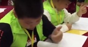 WATCH: Chinese Students Use Bizarre Hand Technique at Math Competition