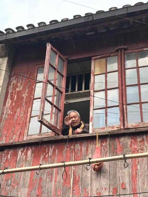 Farewell-Laoximen-man-in-window.jpg