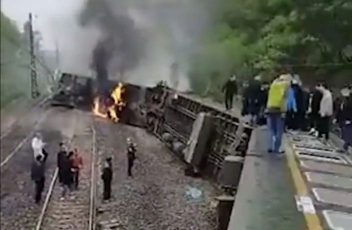 1 Dead After Derailed Train Catches Fire in China
