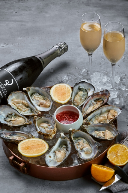1-bottle-champagne-oysters-and-traditional-condiments1.jpg