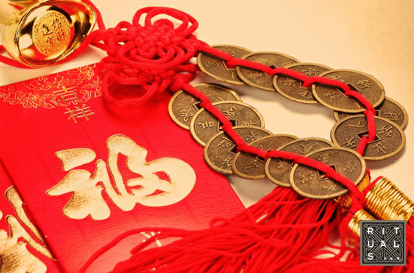 Coins and red thread