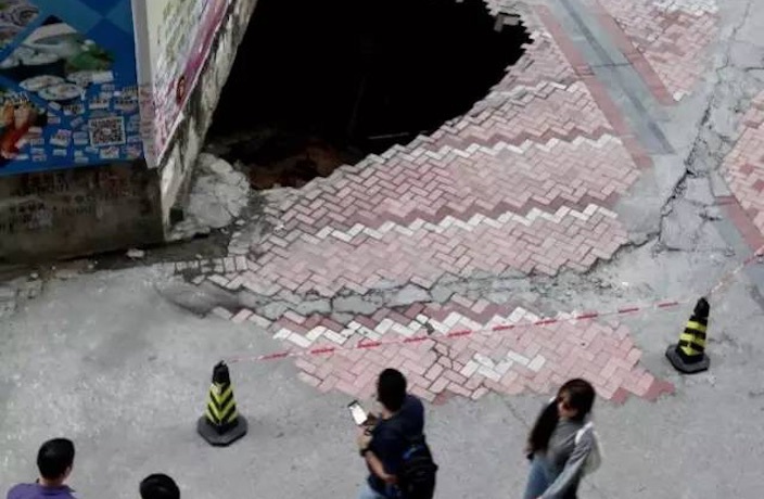 Massive Sinkhole Swallows Bike in Shenzhen's Futian District