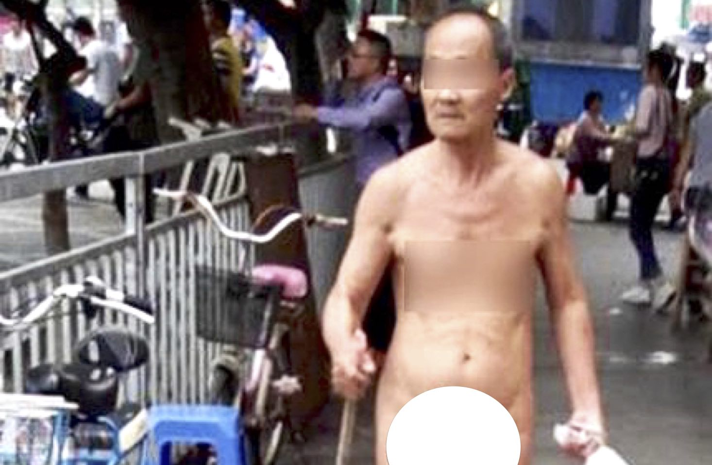 Old Man Strolls Through Dongguan Completely Naked