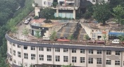 PHOTOS: Road on Rooftop in Chongqing Goes Viral