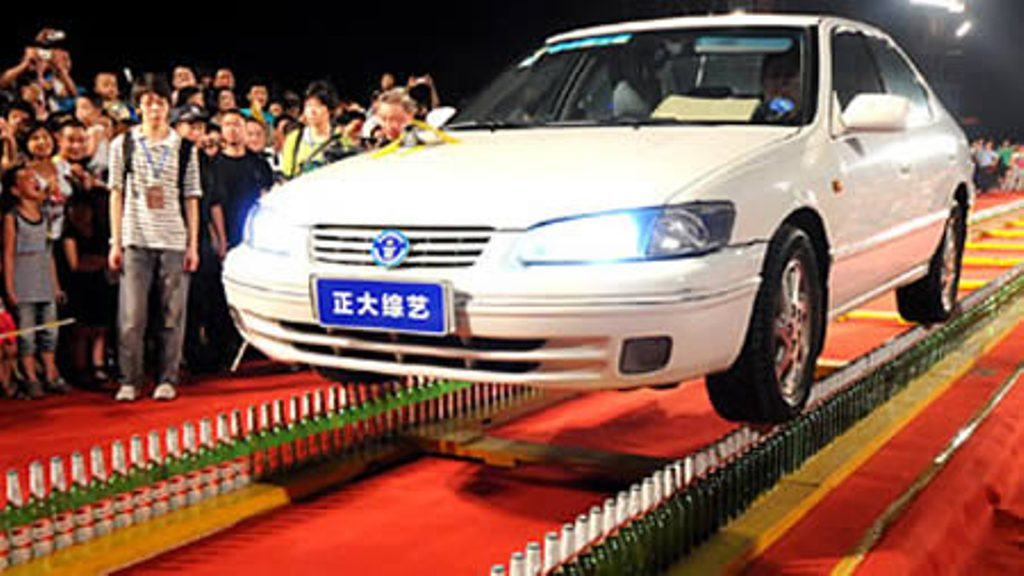 Longest distance driving on glass bottles: 197 feet, 5.68 inches (2010)