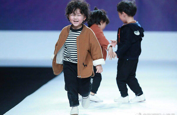 WATCH: Adorable Kid Models Tumble on the Runway at Shanghai Fashion Week