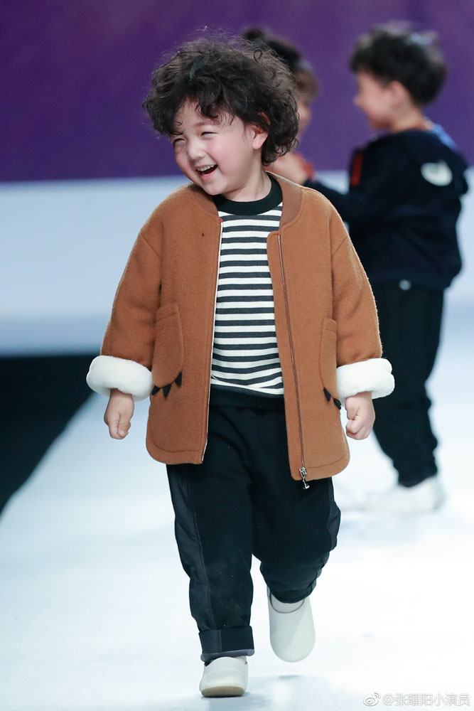 WATCH: Adorable Kid Models Tumble on the Runway at Shanghai
