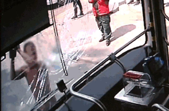 Shirtless Man Attacks Guangzhou Bus with Massive Rock