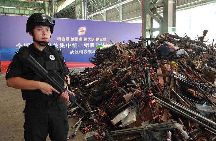 Chinese Police Destroy Over 100,000 Confiscated Illegal Guns