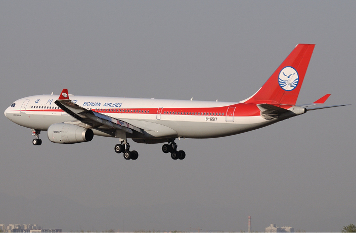Chinese Airline Flight Suspended After 6 COVID-19 Cases Onboard